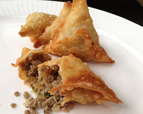 Somali Sambusa is a stuffed triangular pastries with lamb beef